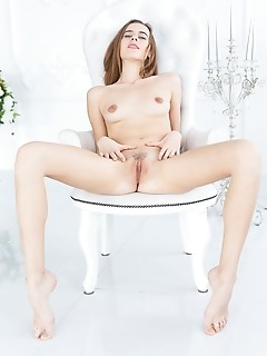 Gracie gracie bares her petite body and sweet cunt as she strips her dress on the chair.