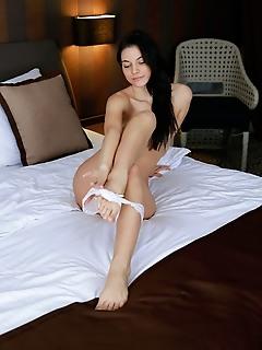 Aleksandrina aleksandrina sensually strips her sexy lingrie on the bed.