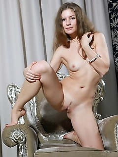 Vivian vivian shows off her trimmed pussy and nubile body on the chair.