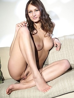Yarina a sultry yarina a sensually strips on the couch baring her smoking hot body.