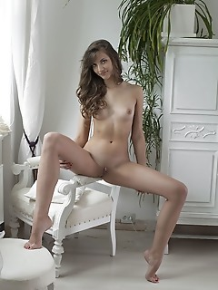 Shari shari showcases her long and slender body with wide open and provocative poses