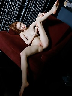 Bella milano redhead bella milano flaunts her petite body and smooth pussy on the couch.
