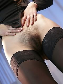 Zavya zavya spreads her long, sexy legs as she flaunts her hairy pussy.