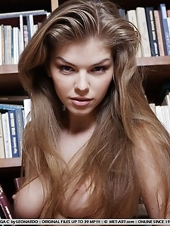 Seductive model in a daring striptease in the library.