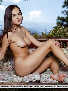 Li moon li moon strips on the couch outdoors baring her her luscious body.