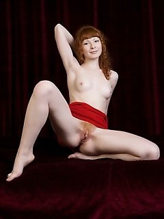 Angelic redhead with milky skin, cute face and natural beauty.