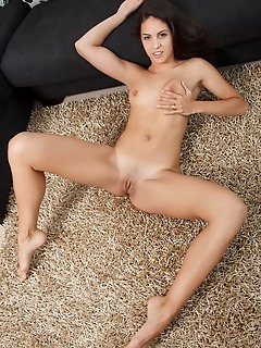 Carolina abril carolina abril delightfully poses on the couch as she shows off her slender body and   delectable pussy.