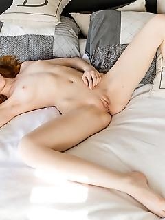 Slender redhead posing