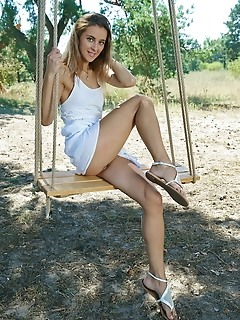 Juck juck playfully poses outdoors as she bares her nubile body on the swing.
