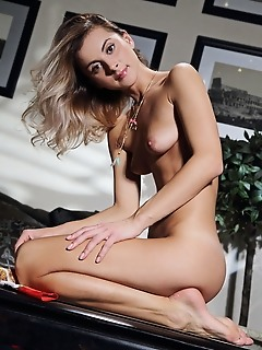 Juck juck bares her sweet pussy as she strips on the couch.