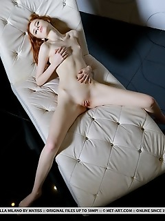 Bella milano redhead bella milano shows off sweet, pink pussy on the couch.