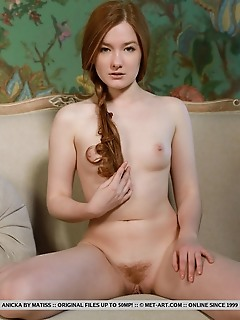 Anicka redhead anicka displays her creamy body and hairy pussy on the couch.