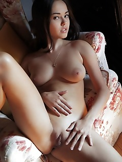 Li moon li moon bares her delectable pussy and amazing tits.