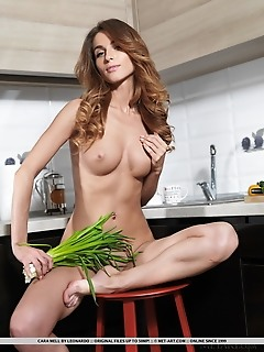 Cara mell cara mell strips in the kitchen as she displays her yummy body.