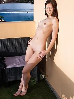 Mina mina flaunts her slender body and sweet pussy outdoors.