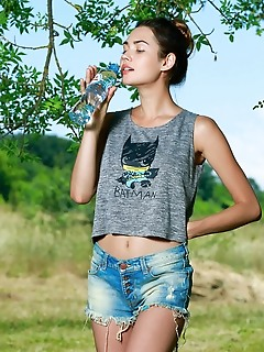 """Georgia """"georgias charming smile and playful poses showcasing her slender physique amidst the green outdoors"""""""