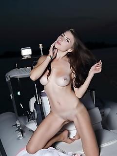 Niemira niemira displays her smoking hot body as she poses on the yacht.