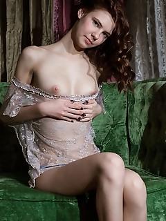 Juliett lea juliett lea bares her pink pussy as she strips on the chair.