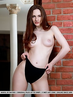 Maryl maryl bares her creamy, white body and puffy tits in front of the camera.