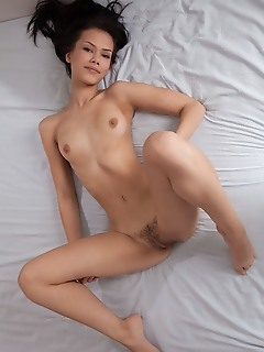 Laina laina sprawls naked in bed and spreads her legs to show off her hairy snatch