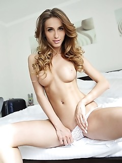 Cara mell alluring cara mell shows off her sexy body as she poses on the bed.