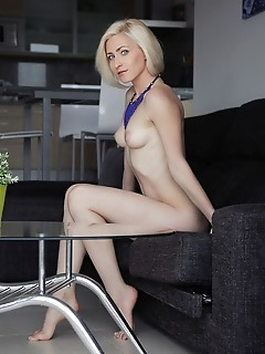 Janelle b gorgeous janelle b bares her creamy, white body with trimmed pussy as she poses on the couch.