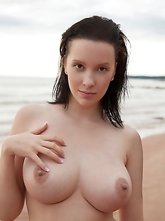 Agatha agatha strips off her diving suit and shows off her magnificent breasts and shaved pussy by the beach