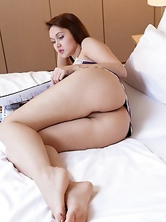 Sintia sintia bares her plump pussy and tight ass on the bed.