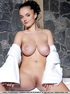 Voluptuous vixen with magnificently large breasts and meaty build.