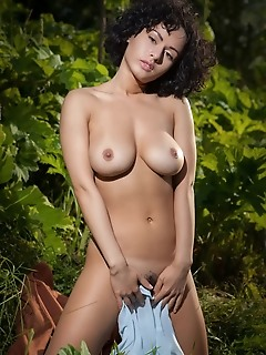 Pammie lee curly-haired pammie lee shows off her curvy body and meaty ass outdoors.