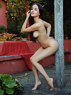Li moon asian beauty li moon playfully poses outdoors as she bares her amazing physique.