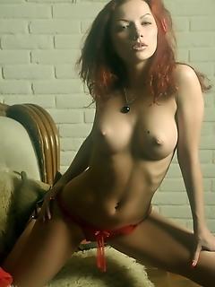 Lusty, fiery hot redhead in erotic debut.
