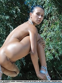 Outdoor charmer with a hot body and erotic poses.