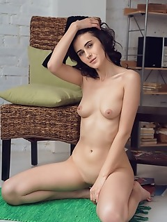 Mona mona strips her sexy high-socks as she bares her smooth pussy on the chair.