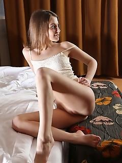 Nikia a nikia a sensually poses on the bed as she flaunst her slender body.