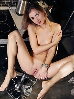 Juck juck bares her wet, pink pussy as she strips on the chair.
