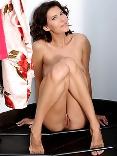 Suzanna a suzanna a shows off her long and slender phsyque and ample assets