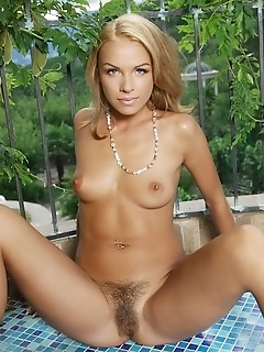 Alluring blonde with sultry gaze and untrimmed bush.