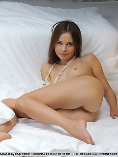 Petite model with nubile body and erotic poses.