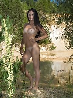Celeste celeste bares her slender, tanned body outdoors.