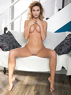 Cara mell gorgeous cara mell smile sweetly for the camera as she poses naked in the sofa