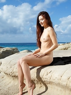 Berenice  top model berenice bares her slender body and small tits outdoors.