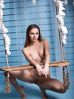Gracie sweet and youthful gracie poses in a wooden swing, showing off her playful yet confident personality