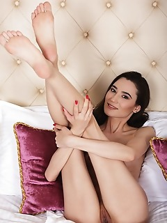 Sofia sun newcomer sofia sun bares her petite body as she strips on the bed.