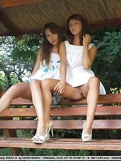 Cute pair flashing each other's luscious bodies.