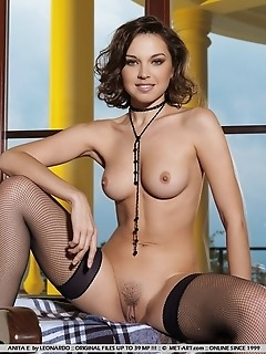 Simply alluring brunette with delectable assets and divine proportions.