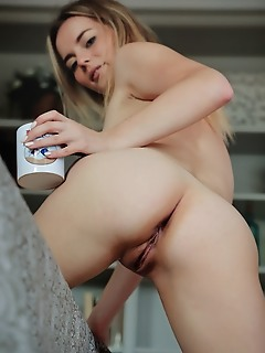 Jillean jillean reveals her sweet natural and small pussy as she drinks her coffee.