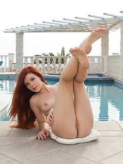 Mia sollis alluring mia sollis bares her grogeous physique as she poses by the pool.