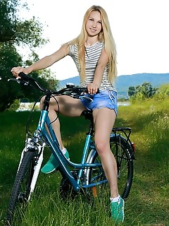 Kendell kendell rides her bike outdoors as she bares her slender body and small pussy.