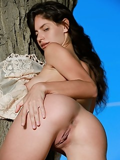 Yasmina yasmina displays her flexible, luscious body as she poses outdoors.